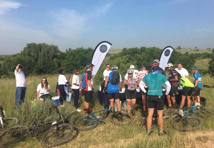Cyclists and staff pictured at one of the water points during the Jackal Dash yesterday. Photo: Facebook/Megan Harrington-Johnson