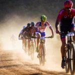 Riders leaving a cloud of dust behind them on a gravel section at the TransCape MTB Encounter. Photo: Jacques Marais