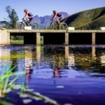 Riders moving across a bridge on the river during the TransCape MTB Encounter. Photo: Jacques Marais