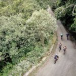 An aerial shot of riders moving along a bend and down a slight descent during the TransCape MTB Encounter. Photo: Jacques Marais