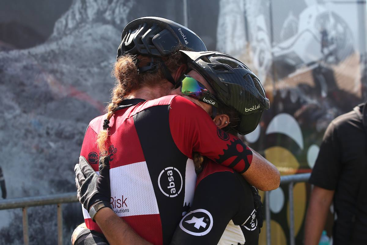 Theresa Ralph (left) and Sarah Hill embrace each other after finishing the seven-day Cape Epic
